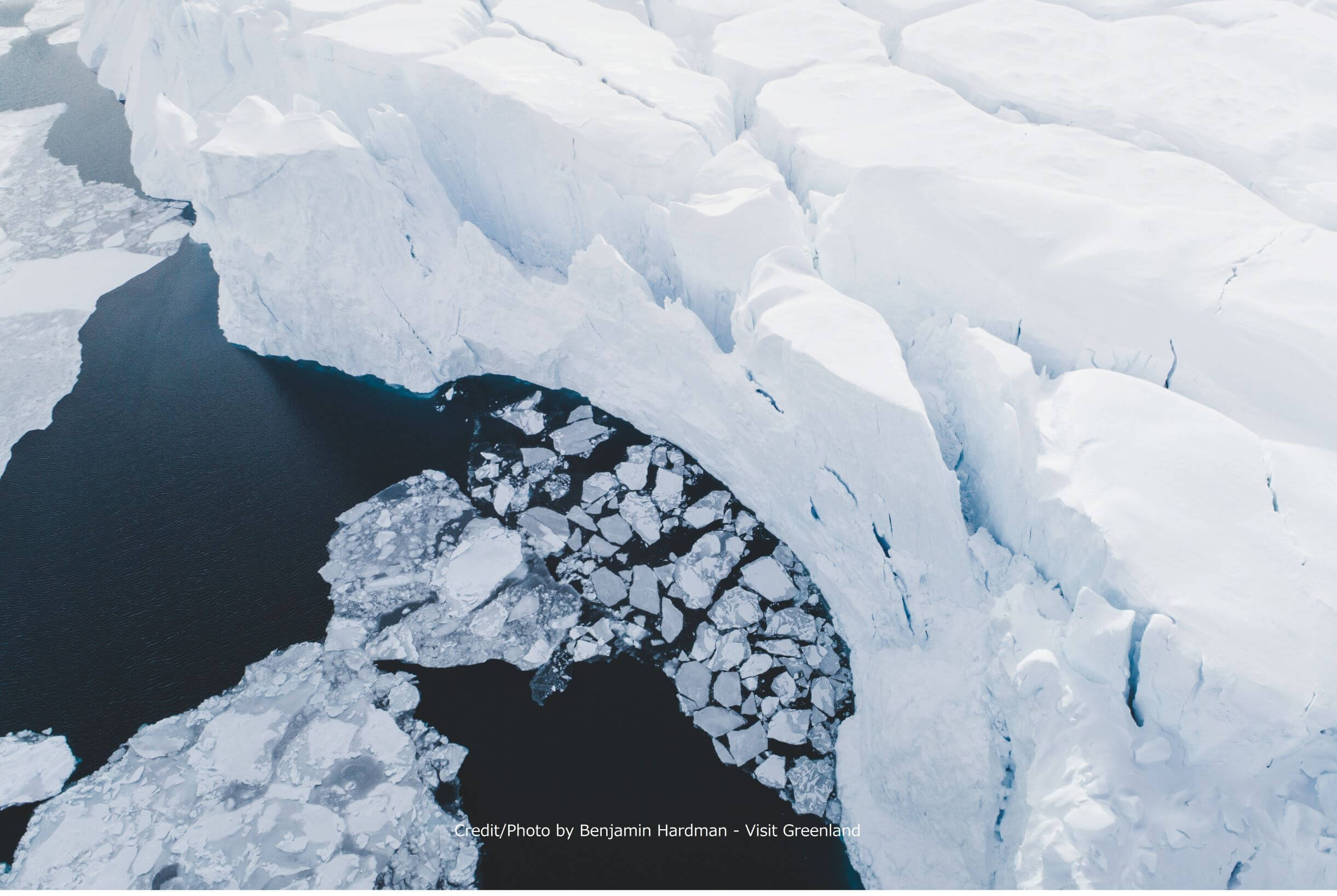 An aerial of the steep ice wall of a large iceberg in Disko Bay3