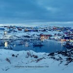 Overview of the Ilulissat harbour during the blue hour in Greenland